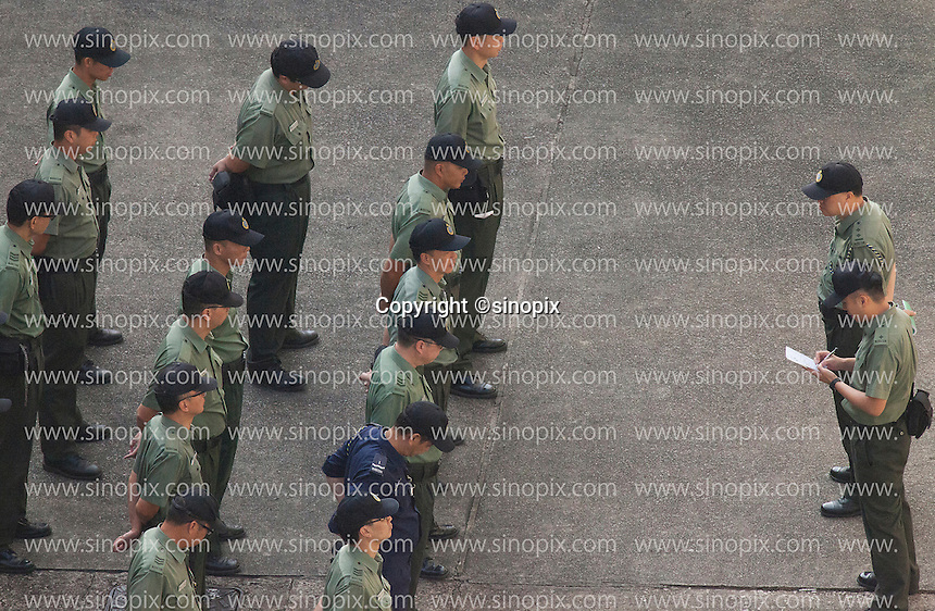 Prison guards stand in formation in a courtyard at the Lai Chi Kok Reception Centre, Hong Kong, China, 01 November 2016.
