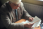 Alfred Wainwright at home in the Lake District Cumbria 1970s with proof pages from new book.