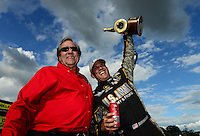 Sept 9, 2012; Clermont, IN, USA: NHRA top fuel dragster driver Tony Schumacher (right) celebrates with father Don Schumacher after winning the US Nationals at Lucas Oil Raceway. Mandatory Credit: Mark J. Rebilas-