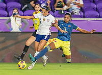 ORLANDO, FL - JANUARY 22: Lynn Williams #6 of the USWNT is tackled by Daniela Arias #3 of Colombia during a game between Colombia and USWNT at Exploria stadium on January 22, 2021 in Orlando, Florida.