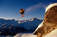 A snow skier goes for big air and a bit of fun.