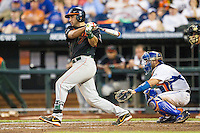 Miami Hurricanes second baseman George Iskenderian (7) follows through on his swing against the Florida Gators in the NCAA College World Series on June 13, 2015 at TD Ameritrade Park in Omaha, Nebraska. Florida defeated Miami 15-3. (Andrew Woolley/Four Seam Images)