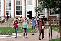 Students walk thru campus at the University of Virginia in Charlottesville, VA. Photo/Andrew Shurtleff