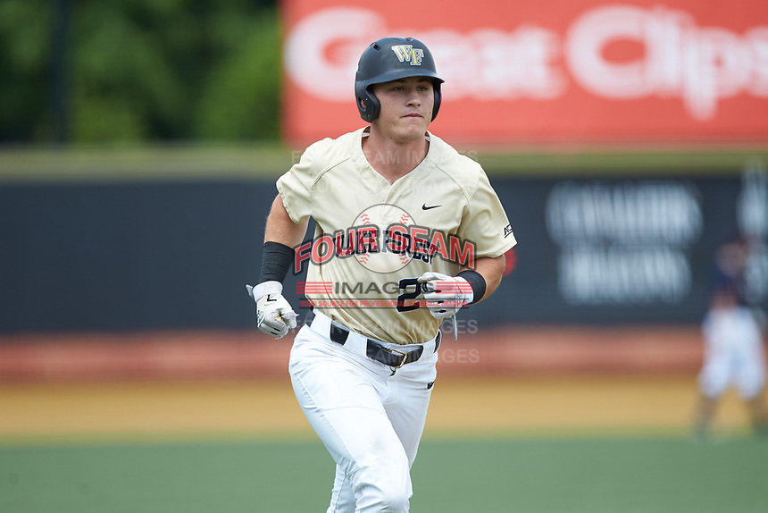 Chris Lanzilli (24) of the Wake Forest Demon Deacons jogs towards home plate after hitting a home run against the Virginia Cavaliers at David F. Couch Ballpark on May 19, 2018 in  Winston-Salem, North Carolina. The Demon Deacons defeated the Cavaliers 18-12. (Brian Westerholt/Four Seam Images)