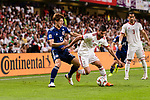 Osako Yuya of Japan (L) fights for the ball with Milad Mohammadikeshmarzi of Iran (R) during the AFC Asian Cup UAE 2019 Semi Finals match between I.R. Iran (IRN) and Japan (JPN) at Hazza Bin Zayed Stadium  on 28 January 2019 in Al Alin, United Arab Emirates. Photo by Marcio Rodrigo Machado / Power Sport Images