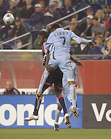 New England Revolution midfielder Shalrie Joseph (21) and Colorado Rapids defender Cory Gibbs (7) battle for a head ball. The New England Revolution tied the Colorado Rapids, 1-1, at Gillette Stadium on May 16, 2009.
