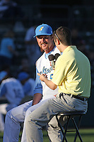 Myrtle Beach Pelicans pitcher Ben Henry #9 being interviewed by Pelicans radio announcer Joel Godett before a game against the Wilmington Blue Rocks at Tickerreturn.com Field at Pelicans Ballpark on April 7, 2012 in Myrtle Beach, SC. Myrtle Beach defeated Wilmington 2-1. (Robert Gurganus/Four Seam Images)