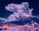 Monsoon Storm over Jerome (Infrared).  In July 2021, we finally, after three years, received some badly needed monsoon rains in Arizona.  This very localized thunderhead popped up one afternoon over the Black Hills above the Verde Valley.  When I captured this image, it was about to drop some much-needed precipitation on the old mining town of Jerome.<br /> <br /> Image ©2021 James D. Peterson<br /> <br /> Tech info: Nikon D3200 camera (modified for infrared with 590nm filter), Nikon 18-140mm lens at 18mm, 1/320 sec. at f11, ISO200.  A vertical panorama made from three vertically stacked images aligned and blended with PTGui panorama software.