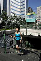Model Released photo of a 21 year old asian (Chinese Filippina), walking - jogging at the exit of Victoria Square metro station, which was given by Paris city in 1967<br /> <br /> <br /> photo : Roussel  - Images Distribution