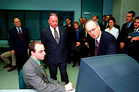 1999 File photo of Quebec's  new Premier, the Honorable Bernard Landry (3rd from left, looking down at the computer) at the inauguration of CAMAQ program in Montreal, Sept 30, 1999.<br /> <br /> Photo by Pierre Roussel