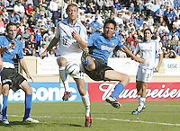 24 October 2004: Brian Ching of Earthquakes dives for the ball against Jimmy Conrad of Wizards at Spartan Stadium in San Jose, California.   Earthquakes defeated Wizards, 2-0.  Credit: Michael Pimentel / ISI