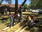 volunteers building home-made monkey bars