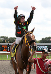 21 August 2010: MEMORIAL MANIAC and Jockey James Graham come to the winner's circle after winning the 79th running of the G3 Stars & Stripes at Arlington Park in Arlington Heights, Illinois.
