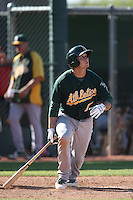 Dusty Coleman #7 of the Oakland Athletics bats during a Minor League Spring Training Game against the Los Angeles Angels at the Los Angeles Angels Spring Training Complex on March 17, 2014 in Tempe, Arizona. (Larry Goren/Four Seam Images)