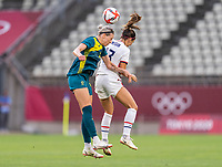 KASHIMA, JAPAN - JULY 27: Alanna Kennedy #14 of Australia goes up for a header with Alex Morgan #13 of the USWNT during a game between Australia and USWNT at Ibaraki Kashima Stadium on July 27, 2021 in Kashima, Japan.
