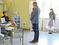 24 June 2020 - Oxford - Prince William Duke of Cambridge talks to a patient (unseen) participating in the Covid-19 vaccine trial at the Oxford Vaccine Group's facility at the Churchill Hospital in Oxford during a visit to learn more about their work to establish a viable vaccine against coronavirus. Trials began on 23rd April, with ten thousand people across the UK in the process of being vaccinated in the latest study to assess the potential success of the treatment, with the UK Government providing £84 million for the University of Oxford to develop and manufacture its coronavirus vaccine. Photo Credit: ALPR/AdMedia