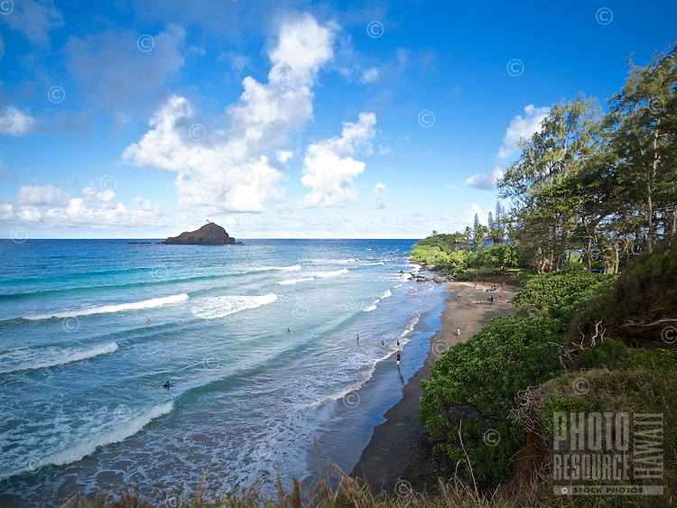 Lines of surf waves rolling toward Koki Beach Park in Hana, Maui.