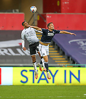 3rd October 2020; Liberty Stadium, Swansea, Glamorgan, Wales; English Football League Championship, Swansea City versus Millwall; Ben Cabango of Swansea City and Ryan Leonard of Millwall challenge for the ball