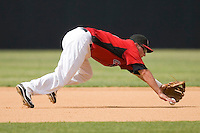 Third baseman Matt West #11 of the Hickory Crawdads knocks down a ground ball at L.P. Frans Stadium June 21, 2009 in Hickory, North Carolina. (Photo by Brian Westerholt / Four Seam Images)