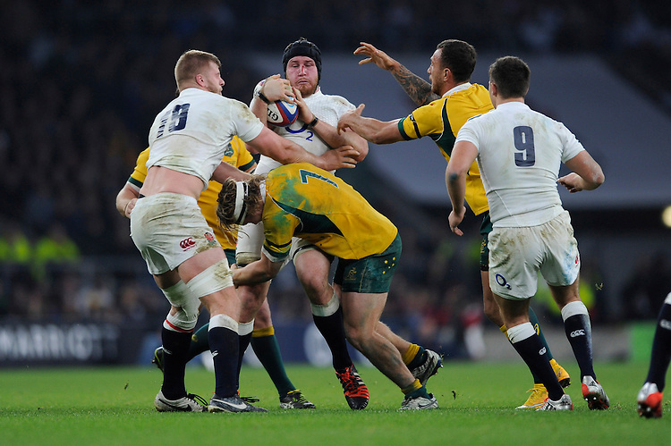 Ben Morgan of England is tackled by Michael Hooper of Australia during the QBE International match between England and Australia at Twickenham Stadium on Saturday 29th November 2014 (Photo by Rob Munro)