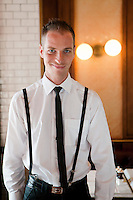 Guillaume, a waiter, poses for the photographer at Bouchon restaurant, Monaco, 23 March 2012