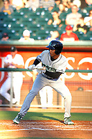 Dayton Dragons outfielder Andy Sugilio (5) squares around to bunt during a game against the Lansing Lugnuts at Cooley Law School Stadium on August 10, 2018 in Lansing, Michigan . Lansing defeated Dayton 11-4.  (Robert Gurganus/Four Seam Images)