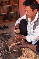 Nepal, Patan.  Woodcarver at Work in his Shop.