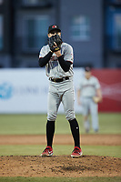 Hickory Crawdads relief pitcher Tai Tiedemann (23) looks to his catcher for the sign against the Greensboro Grasshoppers at First National Bank Field on May 6, 2021 in Greensboro, North Carolina. (Brian Westerholt/Four Seam Images)