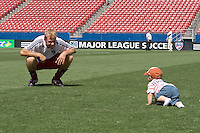 FC Dallas midfielder Bobby Rhine (19) enjoys some time with his son on the field following their 1-0 win over the Chicago Fire. Chicago Fire vs FC Dallas at Pizza Hut Park Frisco, Texas June-15-2008.  FC Dallas 1, Chicago 0.