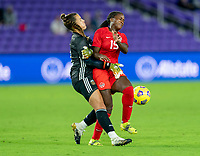ORLANDO, FL - FEBRUARY 21: Solana Pereyra #1 of Argentina collides with Nichelle Prince #15 of Canada during a game between Canada and Argentina at Exploria Stadium on February 21, 2021 in Orlando, Florida.