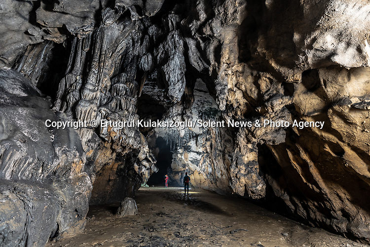 Pictured: Inağzı Cave, Zonguldak, Turkey.<br /> <br /> A team of explorers venture through a series of incredible caves filled with huge stalagmites and underwater lakes.<br /> <br /> The adventurers are carrying out tests in the subterranean world to work out how old the caves are and how they were formed.<br /> <br /> The intriguing images were captured in caves across Turkey by amateur photographer Ertuğrul Kulaksizoglu.  SEE OUR COPY FOR FULL DETAILS.<br /> <br /> <br /> Please byline: Ertugrul Kulaksizoglu/Solent News<br /> <br /> © Ertugrul Kulaksizoglu/Solent News & Photo Agency<br /> UK +44 (0) 2380 458800