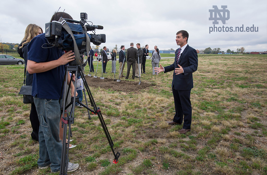 Oct. 15, 2014; Mayor Peter Buttigieg answers questions from reporter after the ground breaking for the ND Turbo Machinery facility in South Bend. Photo by Barbara Johnston/University of Notre Dame)