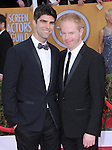 Justin Mikita, Jesse Tyler Ferguson at 19th Annual Screen Actors Guild Awards® at the Shrine Auditorium in Los Angeles, California on January 27,2013                                                                   Copyright 2013 Hollywood Press Agency