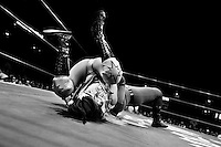 """A female Lucha libre wrestler pins down her rival during a fight at Arena Mexico in Mexico City, Mexico, 26 April 2011. Lucha libre, literally """"free fight"""" in Spanish, is a unique Mexican sporting event and cultural phenomenon. Based on aerial acrobatics, rapid holds and the use of mysterious masks, Lucha libre features the wrestlers as fictional characters (Good vs. Evil). Women wrestlers, known as luchadoras, often wear bright shiny leotards, black pantyhose or other provocative costumes. Given the popularity of Lucha libre in Mexico, many wrestlers have reached the cult status, showing up in movies or TV shows. However, almost all female fighters are amateur part-time wrestlers or housewives. Passing through the dirty remote areas in the peripheries, listening to the obscene screams from the mainly male audience, these no-name luchadoras fight straight on the street and charge about 10 US dollars for a show. Still, most of the young luchadoras train hard and wrestle virtually anywhere dreaming to escape from the poverty and to become a star worshipped by the modern Mexican society."""