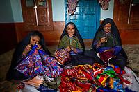 India, Gujarat, Kutch Desert, Bhadroi Village. Pabiben's women employees sewing.