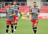 WASHINGTON, DC - JULY 7: Joseph Mora #28 of D.C. United with Felipe Martins #18 of D.C. United warming up during a game between Liga Deportiva Alajuense  and D.C. United at Audi Field on July 7, 2021 in Washington, DC.