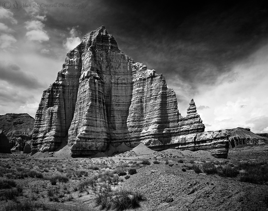 The late afternoon light provides a nice profile of the Temple of the Moon.  This geologic formation is just one of several majestic monoliths found along the Cathedral Valley Road of Capitol Reef National Park.  <br />