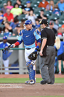 Tennessee Smokies catcher Kyle Schwarber (12) talks with home plate umpire Blake Carnahan during a game against the Chattanooga Lookouts on April 25, 2015 in Kodak, Tennessee. The Smokies defeated the Lookouts 16-10. (Tony Farlow/Four Seam Images)