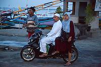 Bali, Indonesia.  Early-morning Visitors to the Jimbaran Fish Market, before Sunrise.