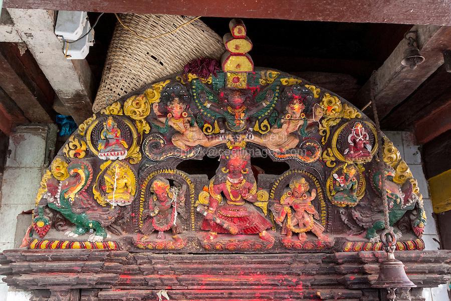 Nepal, Kathmandu.  Wood Carving Depicting Hindu Deities outside a Temple.