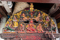Nepal, Kathmandu.  Wood Carving Depicting Hindu Deities outside a Temple.