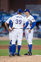 Durham Bulls pitching coach Kyle Snyder (39) has a meeting on the mound with starting pitcher Blake Snell (37) and catcher Luke Maile (26) during the game against the Indianapolis Indians at Durham Bulls Athletic Park on August 4, 2015 in Durham, North Carolina.  The Indians defeated the Bulls 5-1.  (Brian Westerholt/Four Seam Images)