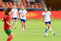 HOUSTON, TX - JUNE 10: Alex Morgan #13 of the United States looks to pass the ball during a game between Portugal and USWNT at BBVA Stadium on June 10, 2021 in Houston, Texas.