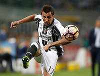Calcio, Serie A: Inter vs Juventus. Milano, stadio San Siro, 18 settembre 2016.<br /> Juventus' Mario Mandzukic kicks the ball during the Italian Serie A football match between FC Inter and Juventus at Milan's San Siro stadium, 18 September 2016.<br /> UPDATE IMAGES PRESS/Isabella Bonotto