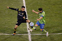COLUMBUS, OH - DECEMBER 12: Lucas Zelarayan #10 of Columbus Crew battles for the ball with Cristian Roldan #7 of Seattle Sounders FC during a game between Seattle Sounders FC and Columbus Crew at MAPFRE Stadium on December 12, 2020 in Columbus, Ohio.