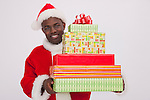 USA, Illinois, Metamora, Santa Claus holding stack of Christmas presents