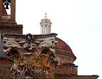 Firenze: An ancient capital with a part of the top of the ancient church of San Lorenzo on the background. In detail, one can see the bell tower and a dome that is lower than the one where are located the Medici chapels, and that corresponds to a sacristy. The peculiar view gives back the beauty of the ancient colors. This photo is an enlargement of a part of the original image.