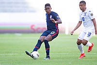 GUADALAJARA, MEXICO - MARCH 28: Andres Perea #15 of the United States dribbles with the ball during a game between Honduras and USMNT U-23 at Estadio Jalisco on March 28, 2021 in Guadalajara, Mexico.