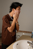 Montreal (Qc) CANADA -Nov 2008-<br /> Model released and Property Released  Photo - Asian (filipino) teenager washing his face