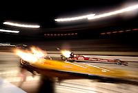 Oct. 31, 2008; Las Vegas, NV, USA: NHRA top fuel dragster driver Doug Kalitta (far lane) races during qualifying for the Las Vegas Nationals at The Strip in Las Vegas. Mandatory Credit: Mark J. Rebilas-